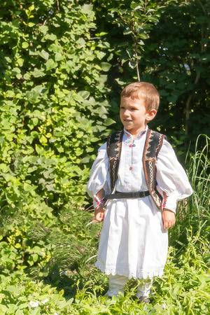 48267153-romanian-peasant-child-who-has-two-years-old-posing-in-traditional-costume